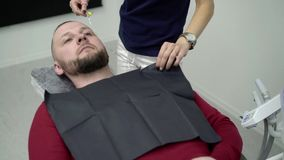 Young man in dental chair. Young man sitting in dental chair stock video