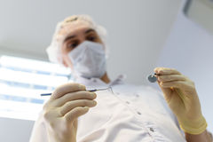 Young man dentist in protection gloves and a mask Royalty Free Stock Images