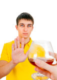 Young Man deny an Alcohol. Young Man refuse Alcohol Isolated on the White Background Royalty Free Stock Photography
