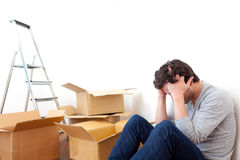 Young man depressed while his moving out his flat Royalty Free Stock Photography