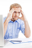 Young man at office thinking Royalty Free Stock Photography