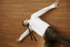 Young businessman in despair lying on the floor Stock Images