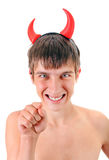 Young Man in Devil Horns. Sly Young Man in Devil Horns on the Head Isolated on the White Background Stock Images