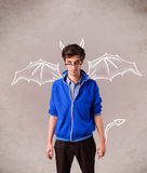 Young man with devil horns and wings drawing Stock Photography