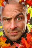 Young man with devilish face. Outside on autumn afternoon Royalty Free Stock Photography