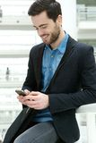 Young man dialling on mobile phone Royalty Free Stock Photo