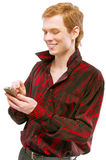 Young man dials number on phone Royalty Free Stock Photo