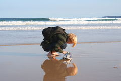 Young man digging in sand Royalty Free Stock Images