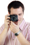 Young man with digital camera Stock Images