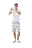 Young man with digital camera. Young man using digital camera in summertime, standing Stock Photo