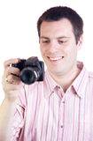 Young man and digital camera Stock Photography