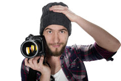 Young man with digital camera isolated Royalty Free Stock Image