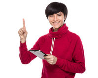Young man with digital tablet and finger point up Royalty Free Stock Photo