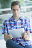 Young man with digital tablet Stock Photos