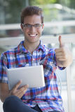Young man with digital tablet Stock Image