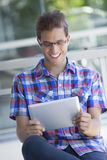 Young man with digital tablet Royalty Free Stock Photos