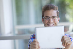 Young man with digital tablet Royalty Free Stock Photo