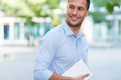 Young man with digital tablet outdoors Stock Images