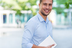 Young man with digital tablet outdoors Stock Photos