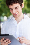 Young man with digital tablet Royalty Free Stock Image