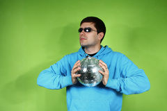 Young man with a discoball Stock Images
