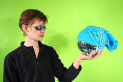 Young man with a discoball Royalty Free Stock Photo