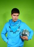 Young man with a discoball Stock Photos