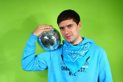 Young man with a discoball Stock Photos