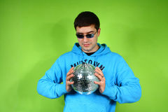 Young man with a discoball Royalty Free Stock Image