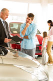Young man discussing with car agent Royalty Free Stock Photo