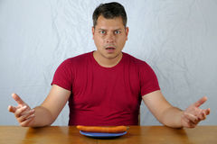 Young man dislike carrot on plate Royalty Free Stock Images