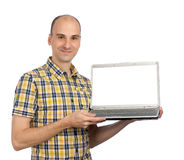 Young man displaying a computer Stock Photography