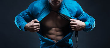Young man displaying his abdominal muscles holding open his styl Royalty Free Stock Image