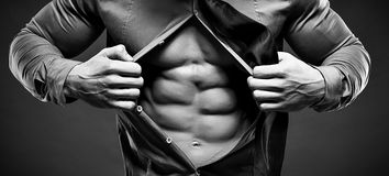 Young man displaying his abdominal muscles Stock Photo