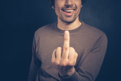 Young man displaying obscene gesture Royalty Free Stock Photography