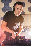 Young man DJ with mixer is working Royalty Free Stock Images