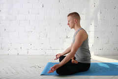 Young man do yoga indoor Stock Photos