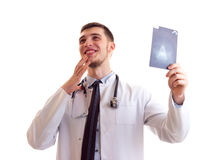 Young man in doctor gown Stock Photo
