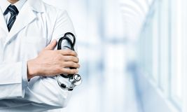 Young man doctor holding stethoscope Stock Photo