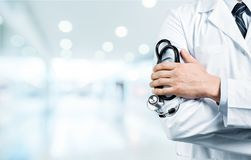 Young man doctor holding stethoscope Stock Image