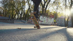 Young man does flip trick on a skateboard stock video footage