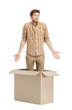 Young man doesn't know why he is inside. The box, isolated, white background Royalty Free Stock Images