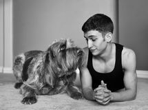Young Man and Dog Stock Photos