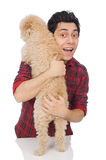 The young man with dog isolated on white. Young man with dog isolated on white Stock Photography