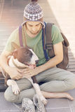 Young man with dog Stock Photo