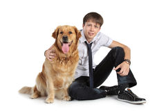 A young man with a dog sitting on floor Royalty Free Stock Image