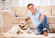 Young man with dog Royalty Free Stock Photography