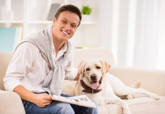 Young man with dog Royalty Free Stock Images