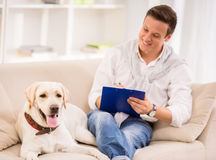 Young man with dog Stock Images