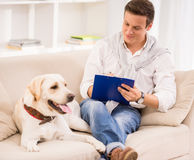 Young man with dog Stock Image